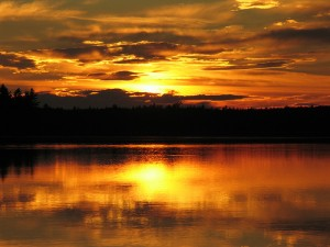 A stunning sunset over a lake in Kejimkujik National Park
