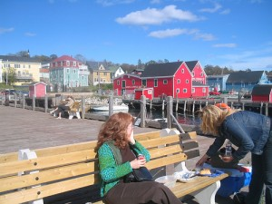 Tourists having a picnic in Lunenburg, a good way to save money!